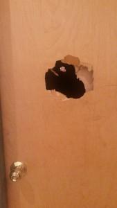 broken punched door